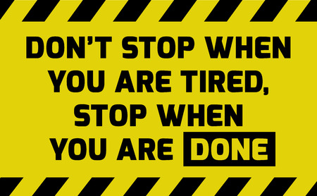 Dont stop when you are tired sign yellow with stripes, road sign variation. Bright vivid sign with warning message.