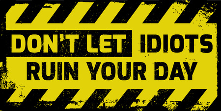Dont let idiots ruin your day sign yellow with stripes, road sign variation. Bright vivid sign with warning message.