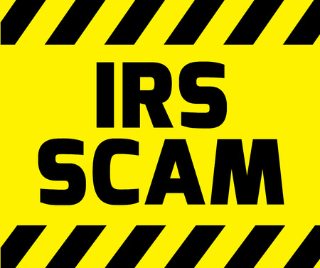 scam: IRS scam sign yellow with stripes, road sign variation. Bright vivid sign with warning message.