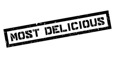 delectable: Most Delicious rubber stamp on white. Print, impress, overprint.