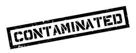 contaminated: Contaminated rubber stamp on white. Print, impress, overprint.
