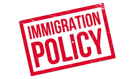 reform: Immigration Policy rubber stamp. Grunge design with dust scratches. Effects can be easily removed for a clean, crisp look. Color is easily changed. Stock Photo