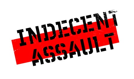 indecent: Indecent Assault rubber stamp. Grunge design with dust scratches. Effects can be easily removed for a clean, crisp look. Color is easily changed. Stock Photo
