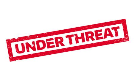 Under Threat rubber stamp