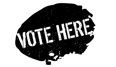 Vote Here rubber stamp Stock Photo