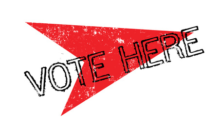 Vote Here rubber stamp Stock Photo