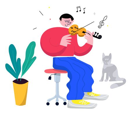 Happy young man enjoys his hobby, playing violin, with his cat sitting by his side.