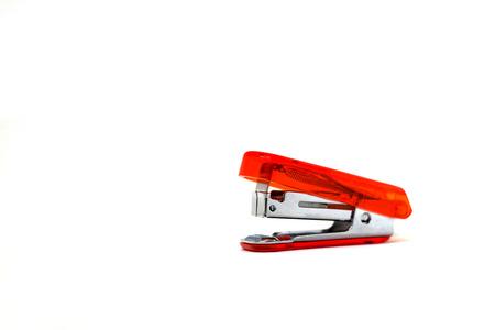 office stapler: orange stapler