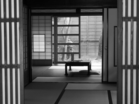 yoga pillows: Traditional Japanese living room opening onto an outside space.  Stock Photo