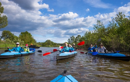 Young people are kayaking in beautiful nature Standard-Bild