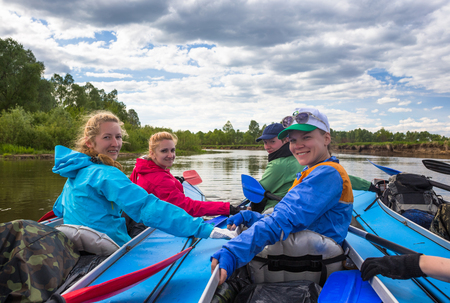 kayaker: Young people are kayaking in beautiful nature Stock Photo