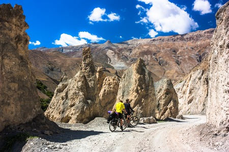 bicycling: Men during bicycling trip in autumn. Himalayas, India Stock Photo