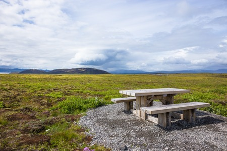 picknick: Wooden picknick bench in green landscape in Iceland
