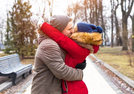 Young happy couple enjoy in winter city park outdoor