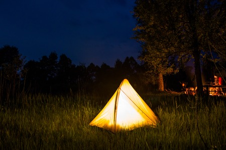 wildness: Yellow tent lighting at night in wildness. Stock Photo