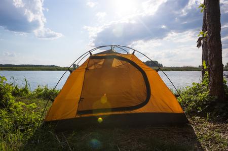 awaking: Tent camp in sunny morning lights. Beautiful sammer nature near river.