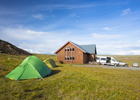 guesthouse: Tent stand near guesthouse in camping, Iceland Stock Photo