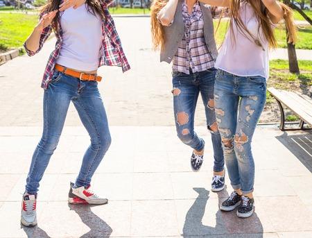 teen legs: Young happy teenagers having fun in summer park