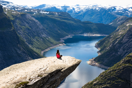 Happy woman enjoy beautiful lake and good weather in Norway.