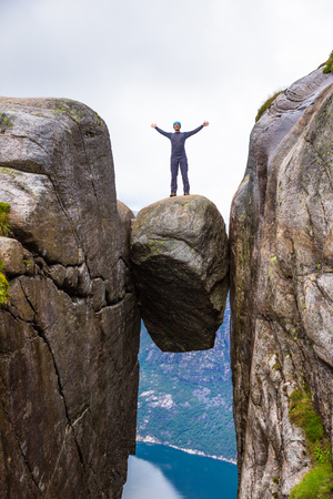 hardanger: Happy tourist having fun on cliff in Norway Stock Photo