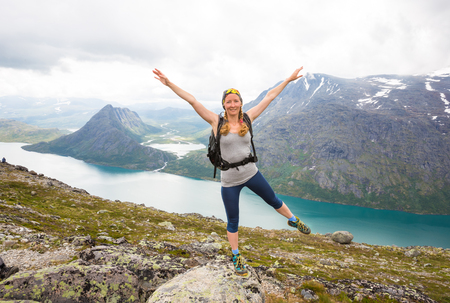 Happy people relax in cliff during trip Norway. Bessegen area