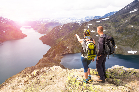 Happy people relax in cliff during trip Norway. Bessegen area. Toning picture
