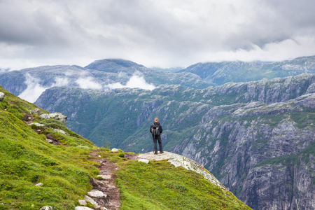 hardanger: Happy people relax in cliff during trip Norway. hiking route