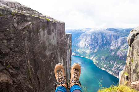 Happy people relax in cliff during trip Norway. hiking route