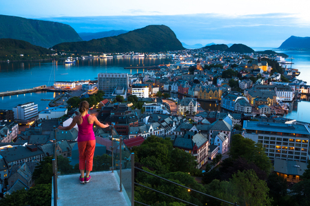 Night view of Alesund. Beautiful lights and reflections in sea. Norway Stock Photo