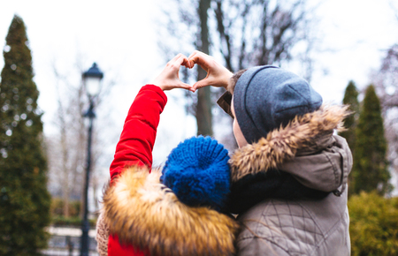 Couple in love walking in winter park and enjoy each others company