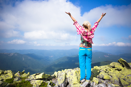 Happy hiker enjoy beautiful mountains. Relax summer time