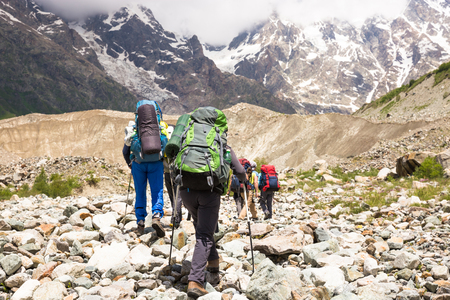 Hiking in beautiful mountains. Group of hikers enjoy sunny weather Standard-Bild