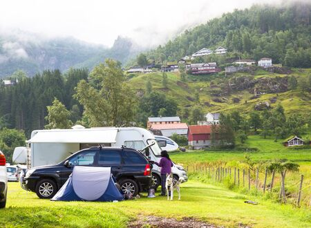 Motorhomes at campsite by the Geirangerfjord in Norway. Concept pictures