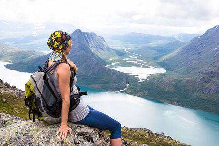 Happy sport woman hiking in Bassegen. Norway