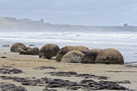 Moeraki Boulders are large, spherical boulders lying on the Koekohe Beach at Moeraki on the South Island of New Zealand