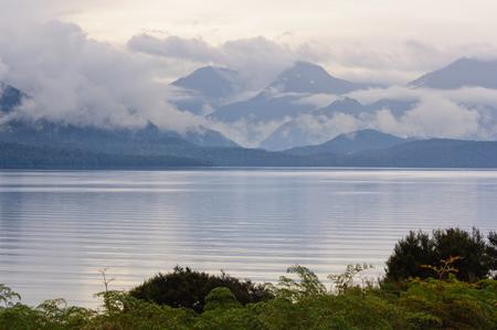 anau: Heavy clouds above and rugged mountains behind Lake Te Anau