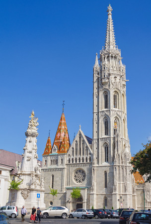 Matthias Church and the Statue of Holy Trinity in Budapest, Hungary Editorial