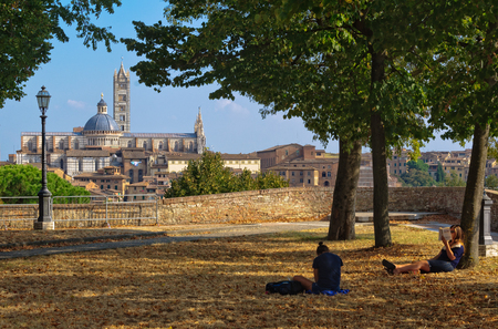 Quiet spot at the Medici Fortress with a beautiful view of the Duomo - Students, 23 September 2011, Siena, Italy Editorial