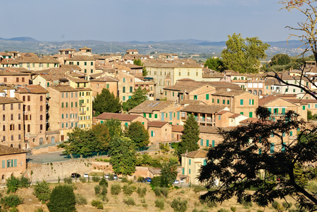 Residential houses below the Tolomei Gardens in Siena, Italy