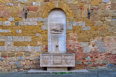 The stone fountain of Contrada Sovrana dellâ??Istrice - Siena, Italy 版權商用圖片