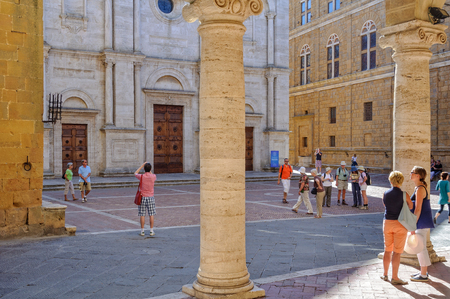 Tourists admire and photograph the Cathedral in the Piazza di Duomo - Pienza, Tuscany, Italy, 3 October 2011 Editorial
