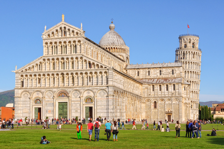 Tourists on the Square of Miracles (Campo dei Miracoli) admire the Duomo and the Leaning Tower (Torre Pendente) in Pisa, Tuscany, Italy - 8 October 2011 Editorial