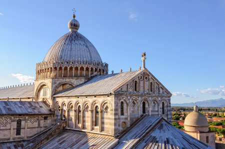 The dome with the Greek cross and the bronze hippogriff on the roof of the Duomo - Pisa, Tuscany, Italy