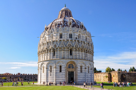Tourists visit the Baptistery (Battistero) on the Square of Miracles (Campo dei Miracoli) in Pisa, Tuscany, Italy - 8 October 2011 Editorial