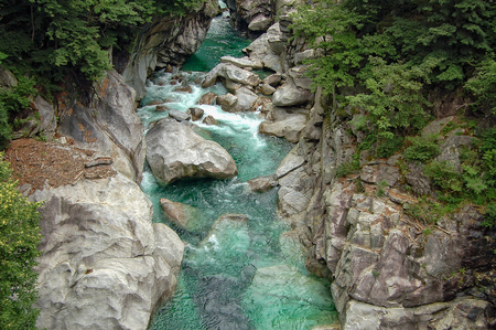 Emerald water of the Verzasca river polishes rocks strenously - Val Verzasca, Switzerland
