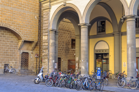 arcades: Bicycle parking in  Pellicceria Street (Via) - Florence, Tuscany, Italy Stock Photo