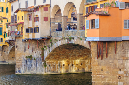 Colourful shops on the Ponte Vecchio above the Arno river - Florence, Tuscany, Italy