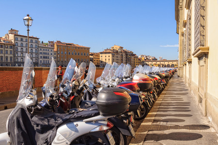 mopeds: Parking mopeds on Lungarno Generale Diaz, an embankment along the Arno river - Florence, Tuscany, Italy, 11 October 2011