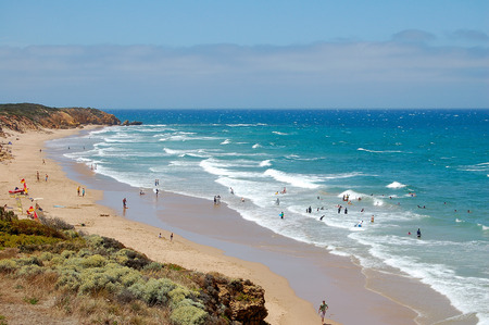 Vacationers enjoy the waves on Bells Beach at Torquay on the Great Ocean Road, Victoria, Australia, 14 January 2009 Stock Photo