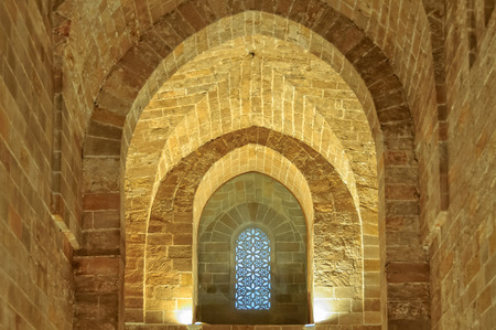 cappella: Plain stone walls and arches and an Arabic-style window in the Royal Chapel (Cappella Palatina) of the Norman Palace (Palazzo dei Normanni) - Palermo, Sicily, Italy